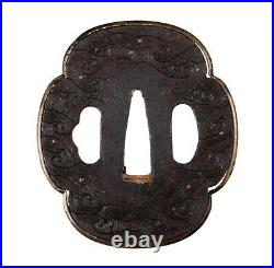 Antique Japanese Iron Tsuba Decorated with Waves, Droplets and Brass Fukurin